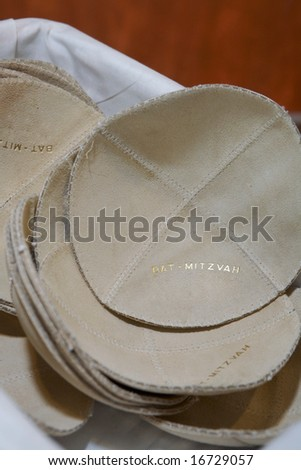 Basket of yarmulka at jewish bat mitzvah - stock photo