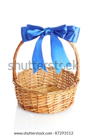 basket with a blue bow isolated on white
