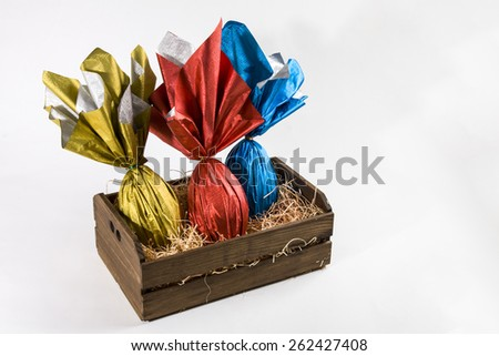 basket with Brazilian Easters eggs, on a white background.