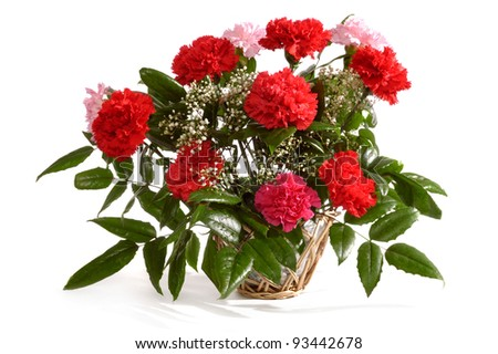 Basket with bunch of red carnations isolated on white background