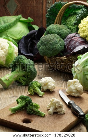 Basket with different cabbages: broccoli, cauliflower, brussel sprouts, chinese cabbage, savoy cabbage, red cabbage - stock photo
