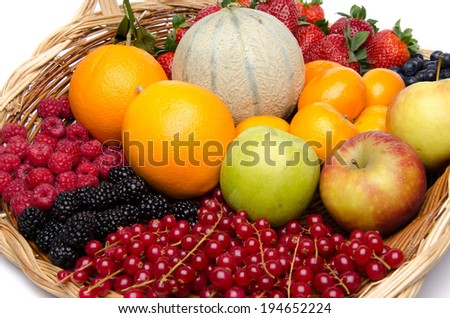 Basket with different fruits, isolated on white - stock photo