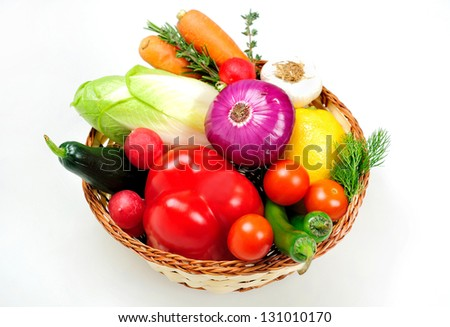 Basket with different raw vegetables
