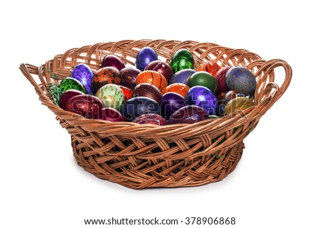 basket with Easter eggs isolated on white