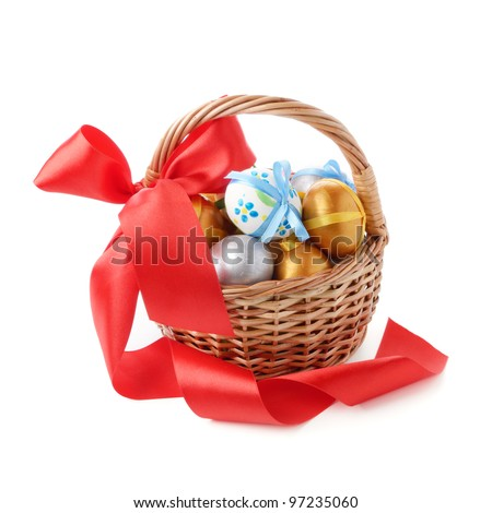 Basket with Easter eggs over white background