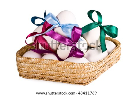 Basket with eggs, on a white background