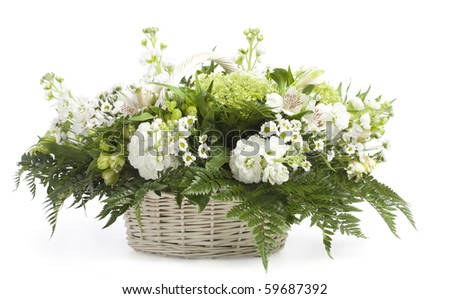 Basket with flowers. Isolated on white - stock photo