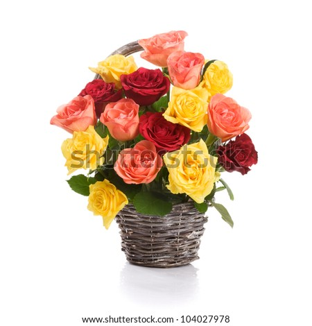 Basket with fresh colorful roses on white background - stock photo