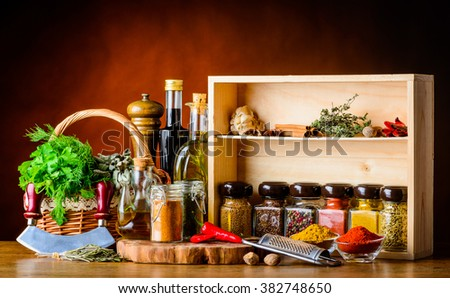 Basket with fresh green herbs and food cooking ingredients and spices - stock photo