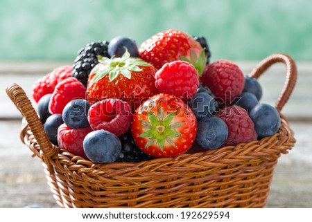 basket with fresh juicy berries, close-up, horizontal - stock photo