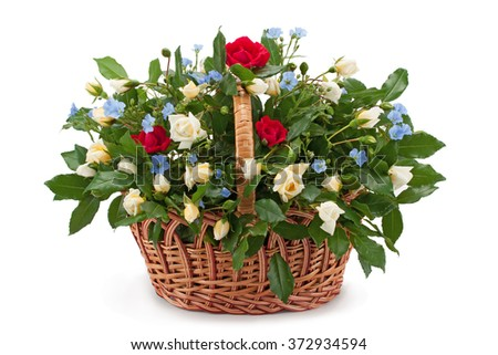 Basket with fresh white and red roses isolated on white background.