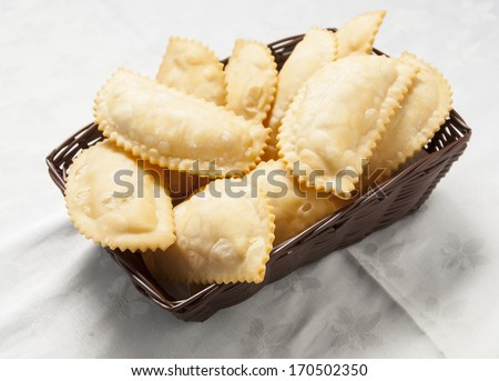 basket with hot and rich cheese pies - stock photo
