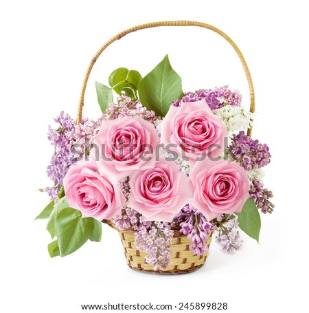 Basket with lilac and roses flowers isolated on white background - stock photo