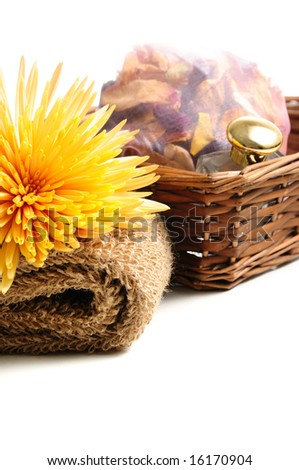 Basket with natural spa elements and chrysanthemum â?? isolated on white