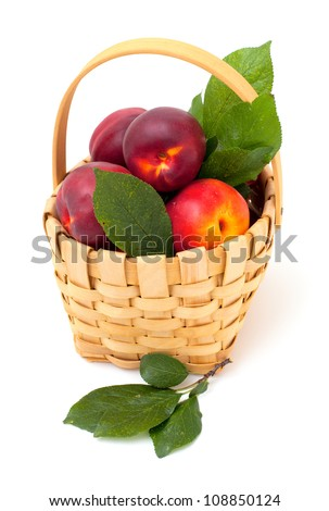 basket with nectarines isolated on white background
