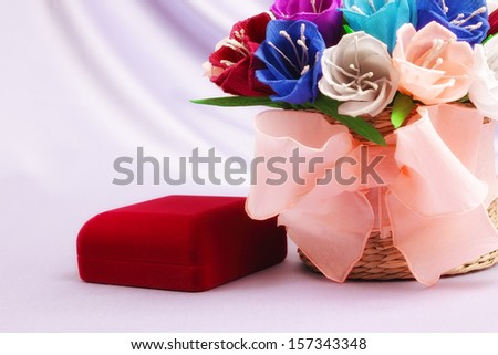 Basket with paper flowers and velvet box - stock photo