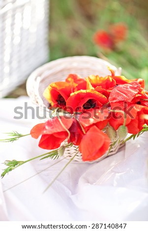 Basket with poppy flowers. Picnic. Summer Mood.
