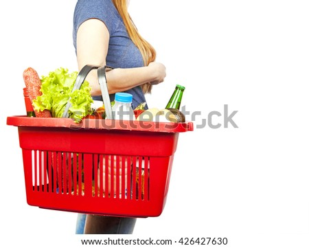 Basket with produce in woman hand - stock photo