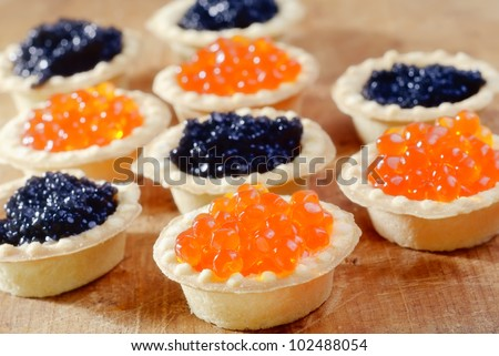 basket with red and black caviar - stock photo