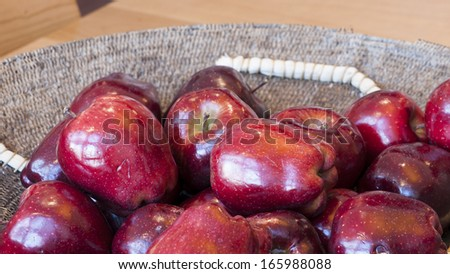 Basket with red apples on the table. - stock photo