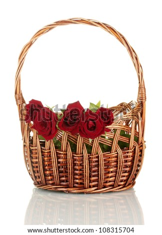 Basket with roses isolated on white background close-up