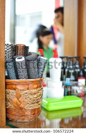 Basket with round hair brushes, mirror on background .Hair accessories - stock photo
