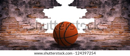 Basketball and old brick wall as background - stock photo