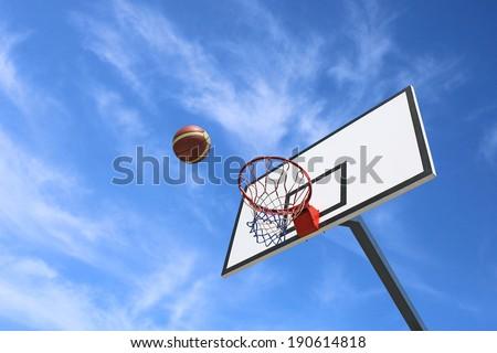 Basketball backboard and blue sky background - stock photo