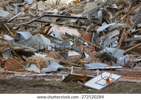 basketball backboard and ruins of the old brick building - stock photo