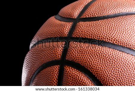 Basketball ball against dark background - stock photo
