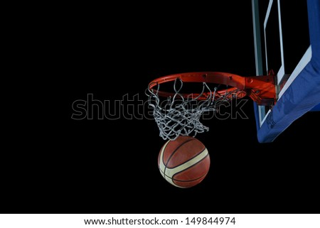 Basketball ball,  board and net  on black background in gym indoor - stock photo