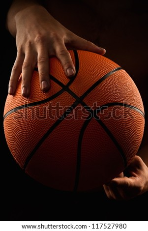 Basketball ball in male hands