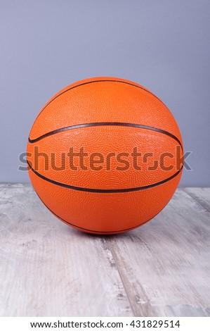 Basketball ball isolated on the reclaimed wood floor - stock photo