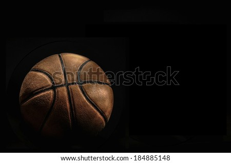 Basketball ball on black background, with room to add your text (light painting technique)
