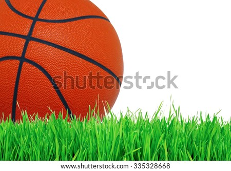 Basketball ball on green grass over white, close up - stock photo