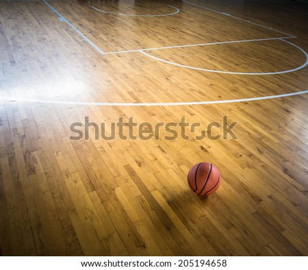 Basketball ball over floor in the gym - stock photo