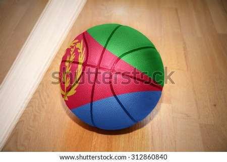 basketball ball with the national flag of eritrea lying on the floor near the white line - stock photo