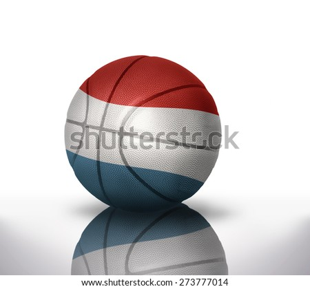 basketball ball with the national flag of luxembourg on a white background - stock photo