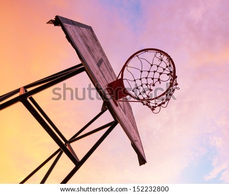 Basketball board on sunset sky - stock photo
