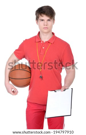 Basketball coach. A young basketball coach, basketball ball and whistle. isolated on white background - stock photo