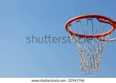 Basketball hoop against blue skies. Concept shot of aim, destination, goal, target