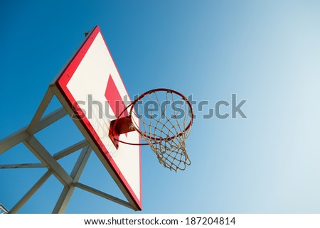 Basketball hoop against blue sky. - stock photo