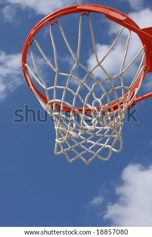 Basketball hoop against cloudy sky