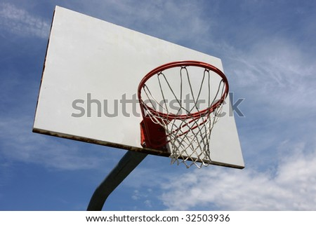 Basketball hoop against sky - stock photo