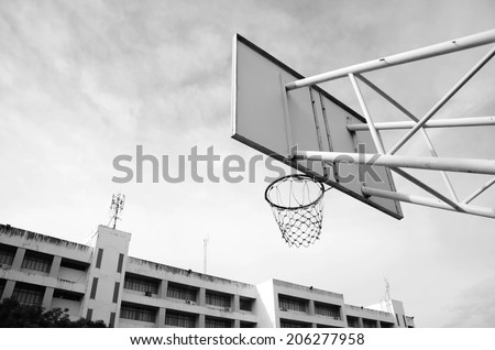 Basketball hoop against the sky. Processed with vintage style. - stock photo