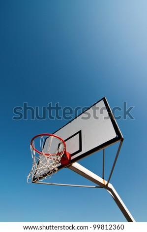 Basketball hoop against the warm summer sky. - stock photo