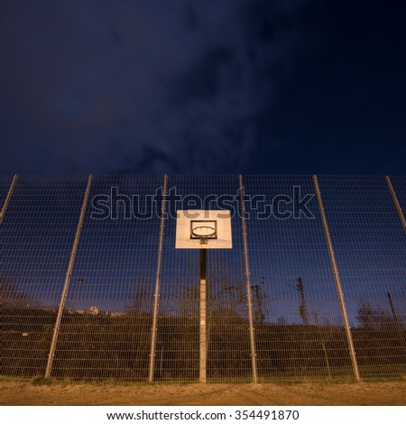 basketball hoop at outdoor court in night sky  - stock photo