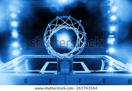Basketball Hoop in a sports arena (blue toned) - stock photo