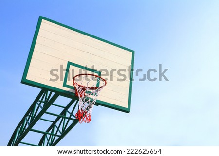 basketball hoop in blue sky - stock photo