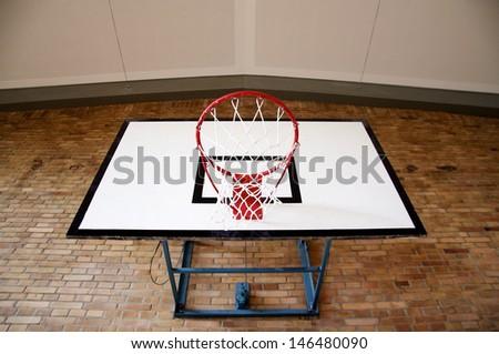Basketball Hoop inside a Gym seen from below - stock photo